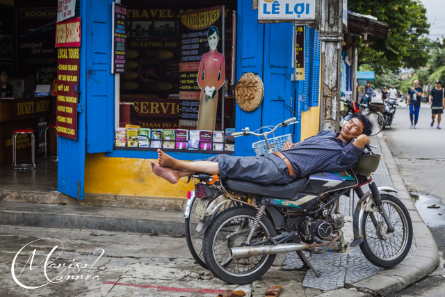 Man taking a nap on a bike